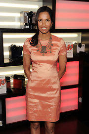 Padma Lakshmi adorned her simple coral dress with a beaded statement necklace for a Nespresso event.