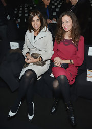 Carine Roitfeld paired elegant white cap-toe pumps with a trenchcoat for the Diane Von Furstenberg fashion show.