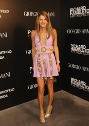 Anna dello Russo turned up the heat in an embellished purple Fausto Puglisi dress with a cleavage-baring neckline during the 'Richard Hambleton: A Retrospective' art opening.