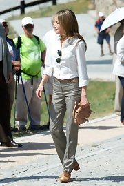 Princess Letizia kept it comfy in flat camel-colored Oxfords.