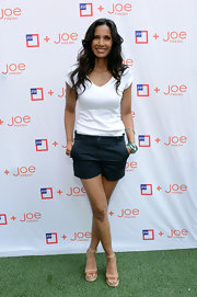 Padma Lakshmi teamed her shorts with a plain white V-neck tee.