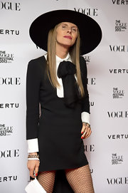 Anna dello Russo traded in her wacky hats for this classic black wide-brimmed number when she attended the Vogue Festival opening party.