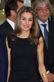 Princess Letizia styled a simple LBD with a gorgeous gold cuff bracelet when she attended the Circulo de Lectores anniversary ceremony.