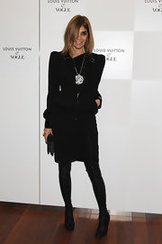 Carine Roitfeld was edgy-stylish in black knee-high boots and a moto-chic jacket during the Terry Richardson exhibition opening.