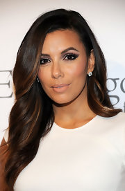 For her lips, Eva Longoria went subtle with a nude shade.