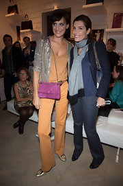 Ines de la Fressange swung a purple shoulder bag at Roger Vivier's Prismick A/W 2012 party.