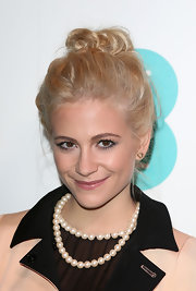 Pixie Lott finished off her look with a cute top knot.