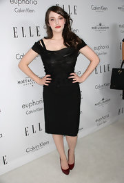 Kat Dennings injected a spot of color with a pair of red platform pumps.