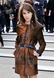 Caroline Sieber added shape to her boxy coat by cinching it with a black leather belt.