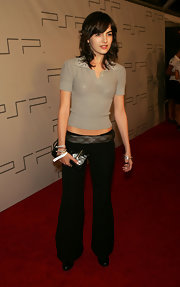 Camilla Belle opted for a casual taupe polo shirt with an embellished collar when she attended the Pret a PSP event.
