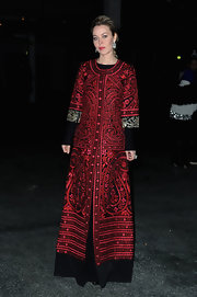 Ulyana Sergeenko attended the Givenchy show wearing the most perfectly regal opera coat.