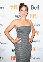 Marion Cotillard paired a woven gold cuff with a strapless tweed dress, both by Dior, for the 'Rust and Bone' premiere.