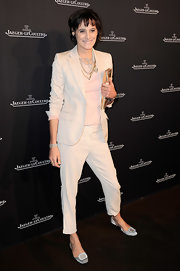 Ines de la Fressange was all about comfort and chose to wear a pair of white embellished flats at a boutique opening.