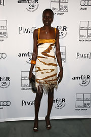 Alek Wek was '20s-chic in a fringed slip dress during the amfAR Inspiration Gala.