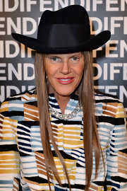 Anna dello Russo's headwear of choice for the Fendi fashion show was a black cowboy hat designed by Stephen Jones Millinery for Giambattista Valli.