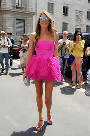 Anna dello Russo looked sassy at the Ferragamo fashion show in a feather-embellished hot-pink strapless top and matching shorts by Oscar de la Renta.