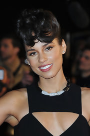 Alicia Keys rocked a short 'do with sculpted bangs at the 2013 NRJ Music Awards.