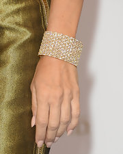 For her nails, Celine opted for a simple nude hue.