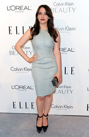 Kat Dennings completed her minimalist-chic look with a pewter box clutch.