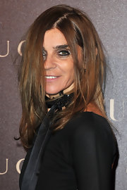 Carine Roitfeld amped up the edge factor with heavily lined eyes teamed with a messy hairstyle.