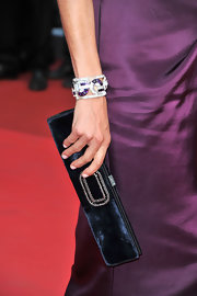 Ines de la Fressange oozed with elegance as she styled her satin gown with a diamond studded bracelet at the 64th Cannes Film Festival.