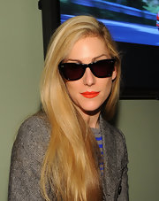Joanna Hillman hid her eyes behind a pair of wayfarers as she posed for photographers during Mercedes-Benz Fashion Week.