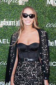 Harley Viera-Newton looked sexy and girly in a black lace cardigan and a matching corset dress at the Couture Council Fashion Visionary Awards.