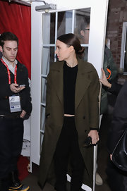 Rooney Mara was spotted at Village at the Lift 2013 wearing an army-green wool coat over a black crop-top and pants.