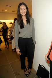 Liu Wen was masculine-chic in her black slacks and taupe shirt combo.