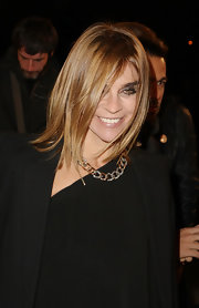 Carine Roitfeld attended the Chanel Mobile Art party wearing a beautiful gold and diamond chain necklace.