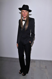 Anna dello Russo attended the Costume National Homme fashion show show looking menswear-chic in a black YSL tux.