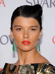 Crystal Renn finished off her vibrant look with a pair of dangling jade earrings.