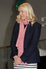 Princess Mette-Marit teamed a pink knit scarf with her jacket when she visited the Scandic Vulkan Hotel.