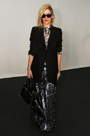 Joanna Hillman contrasted her glam skirt with a masculine-chic black blazer.