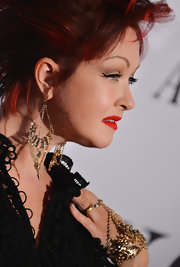 Cyndi Lauper wore crystal and chain chandelier earrings at the 2013 Tony Awards.