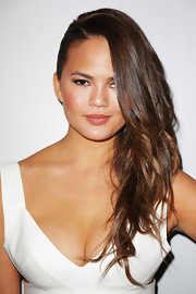 Chrissy Teigen sported an edgy side sweep during Mercedes-Benz Fashion Week Swim 2014.