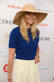 Jessica Hart topped off her look with a summer-chic straw hat when she attended OCRF's Super Saturday.
