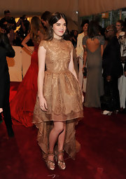 Hailee Steinfeld stunned in bronze spring 2011 Lattie and Tassel-detailed sandals.