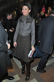 Giovanna Battaglia wore a pair of black knee-high boots for added warmth and style.