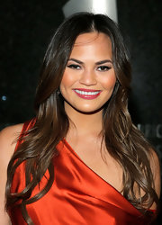 Chrissy Teigen wore her hair in sexy waves with a center part during the Hip-Hop Inaugural Ball.