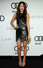 Ashley Madekwe styled her LBD with glamorous gold T-strap sandals by Topshop.
