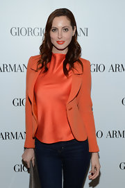This statement tangerine blazer hugged Eva's stunning silhouette to perfection at a beauty event in Los Angeles.
