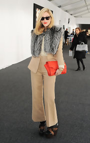 Joanna Hillman accessorized with a gray fur scarf for added glamour to her look.