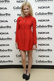 Pixie Lott chose black tassel loafers instead of heels to complete her look.