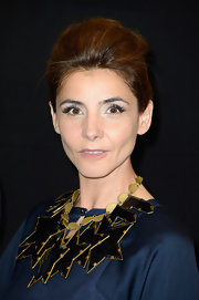 Clotilde Courau added major oomph with an oversized black and gold star necklace.