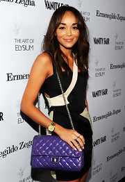Ashley Madekwe attended the Vanity Fair LA event wearing a Michael Kors chronograph watch in gold-tone stainless steel.