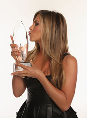 Jennifer Aniston shunned color for her People's Choice Awards look, pairing neutral nail polish with a black dress.