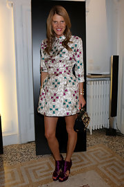 Anna dello Russo complemented her outfit with a vintage-glam Dolce & Gabbana beaded purse.