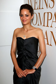 Marion Cotillard amped up the luxe factor with a Chopard diamond watch during the Nine Official Drinks Party.