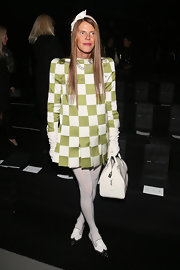 Anna dello Russo finished off her look with a stylish white bowler bag by Louis Vuitton.